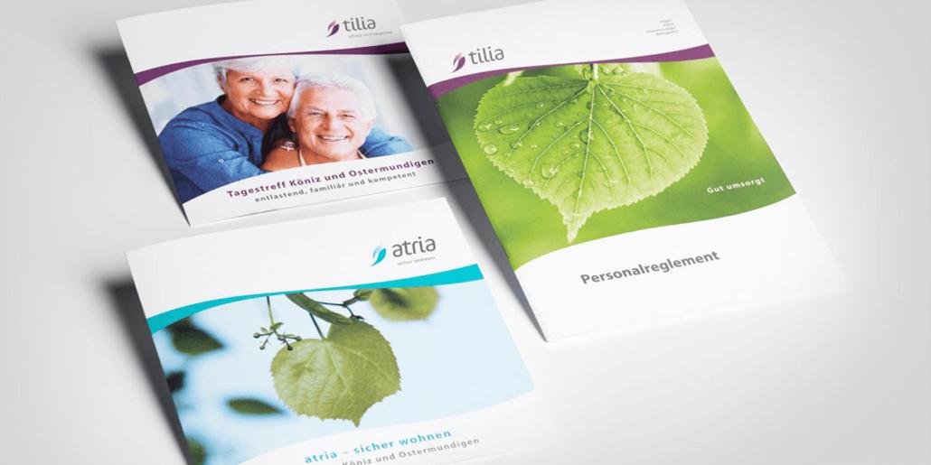 Drei verschiedene Broschüren mit dem neuen tilia und atria Logo.